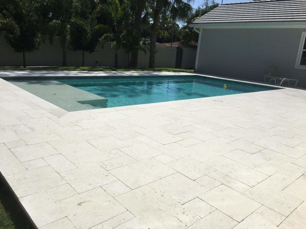 travertine pavers around pool