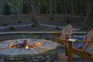 fire pit with two chairs around it