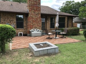 Backyard of a house with paver brick patio.